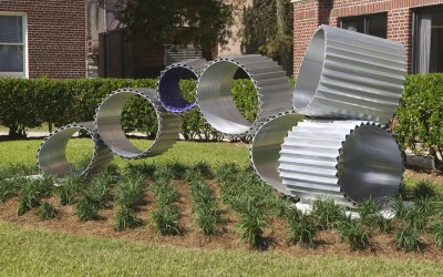 New Morning, 2007. Aluminum, glass; 54 x 60 x 12. Collection of Loyola University New Orleans.